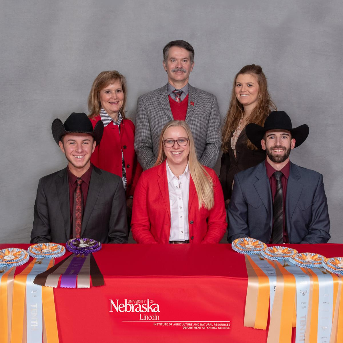 6 members of the horse judging team                                     pose for a picture