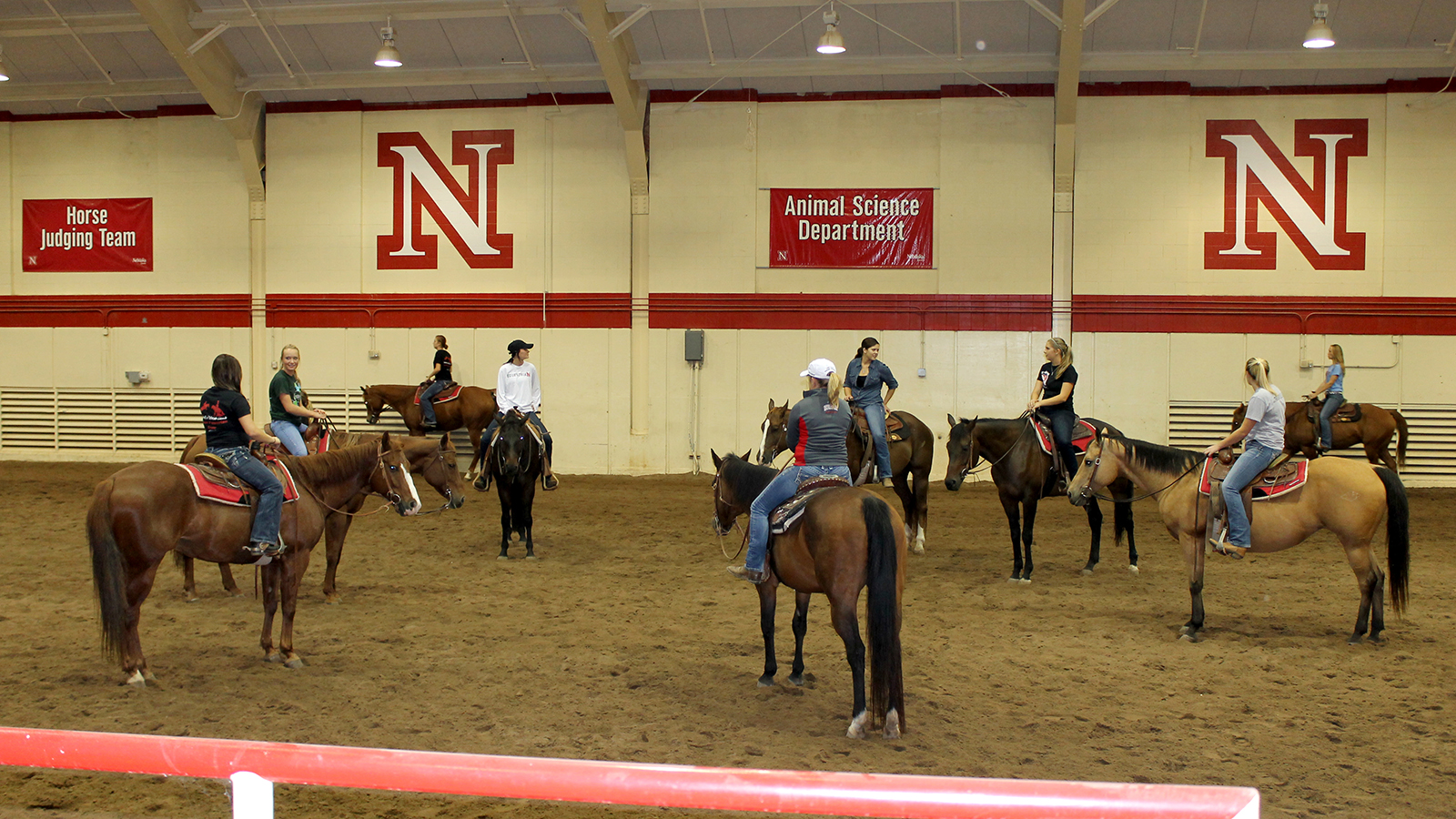 Students on horses in the arena