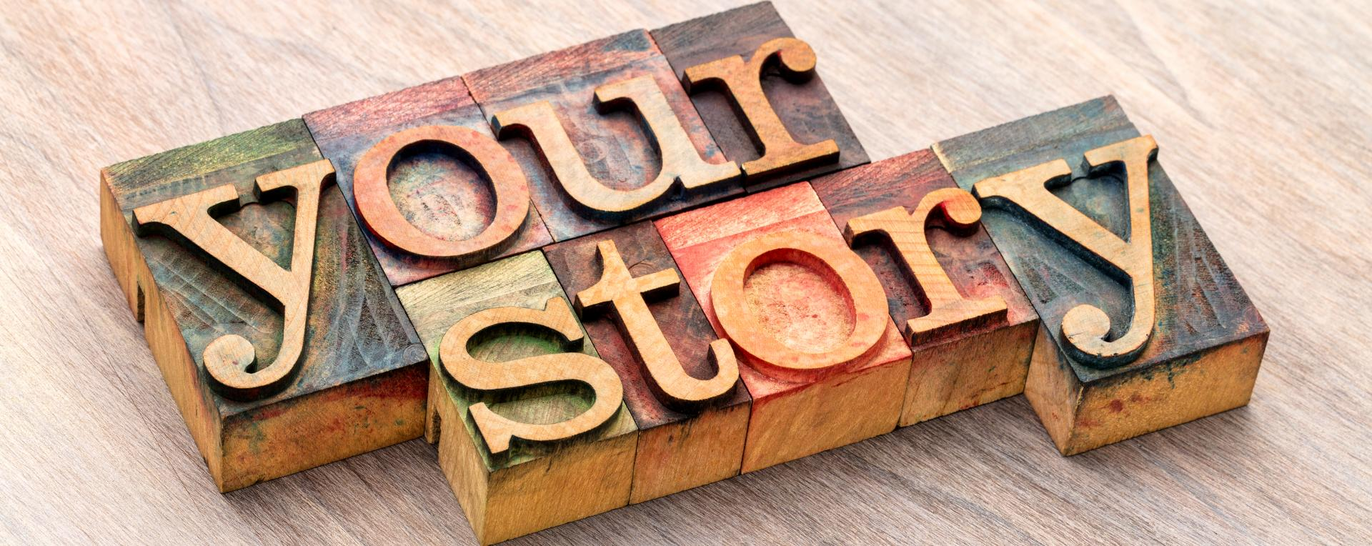 picture of 'Your Story' spelled from building blocks