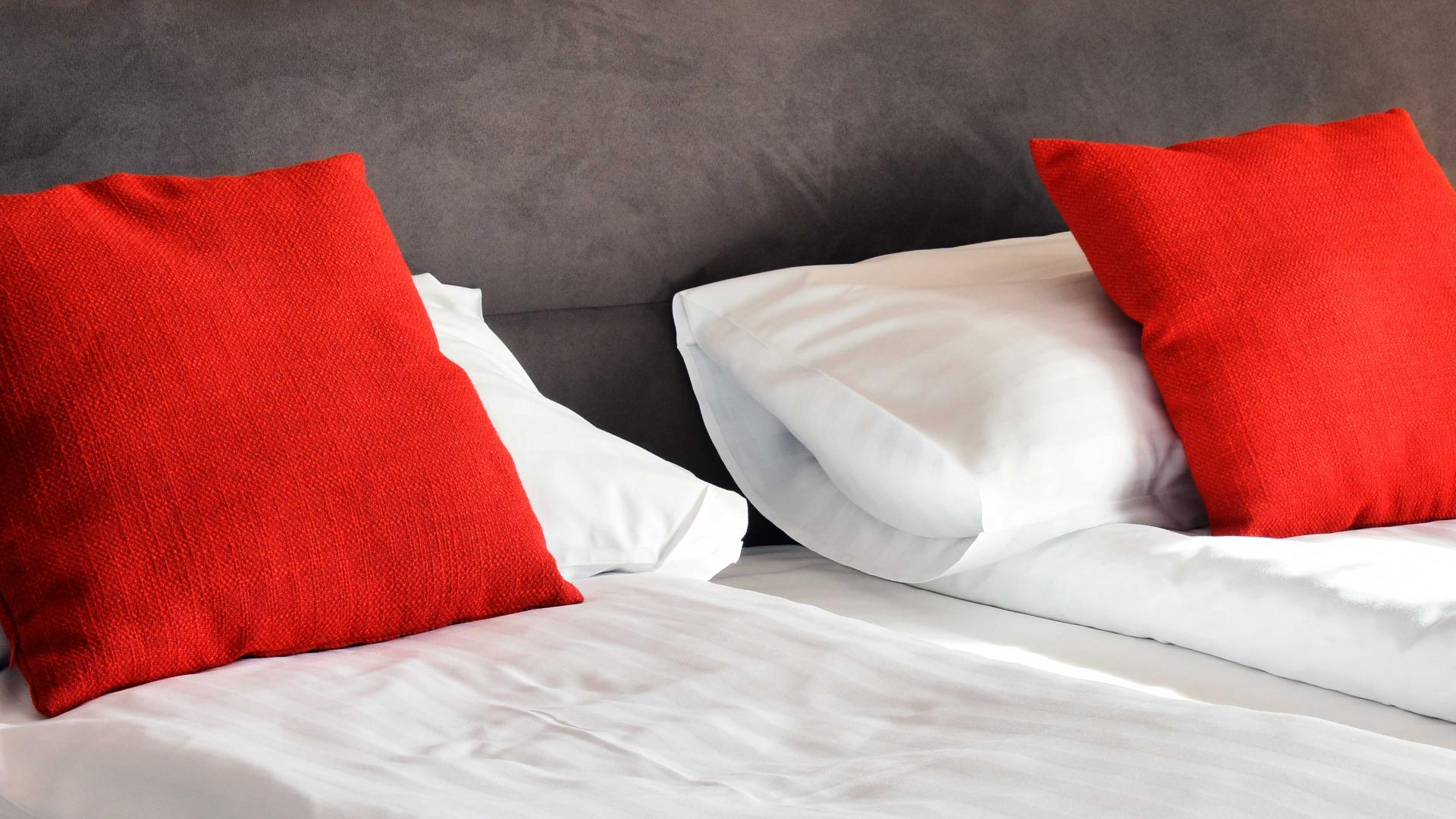 bed with red pillows