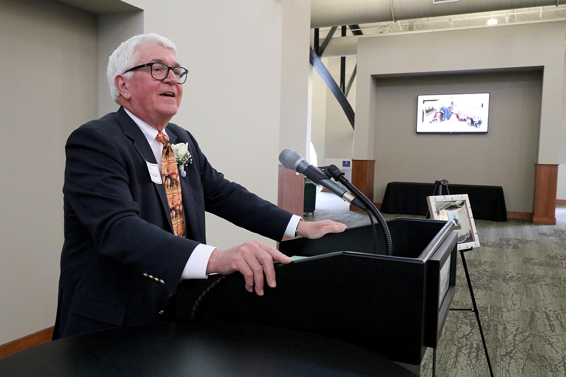 Chuck Schroeder speaks at the podium